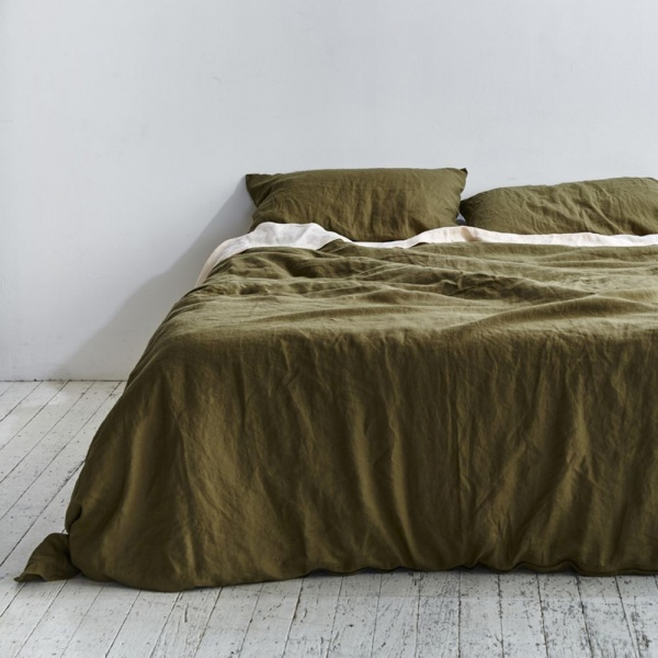 In Bed Store linen sheets in moss green