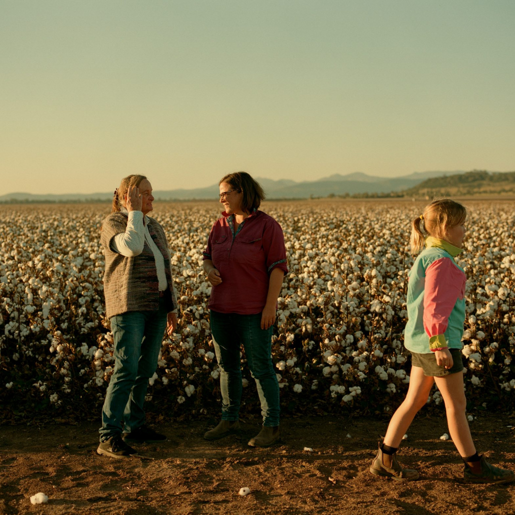 Three female farmers in front of cotton field farmers